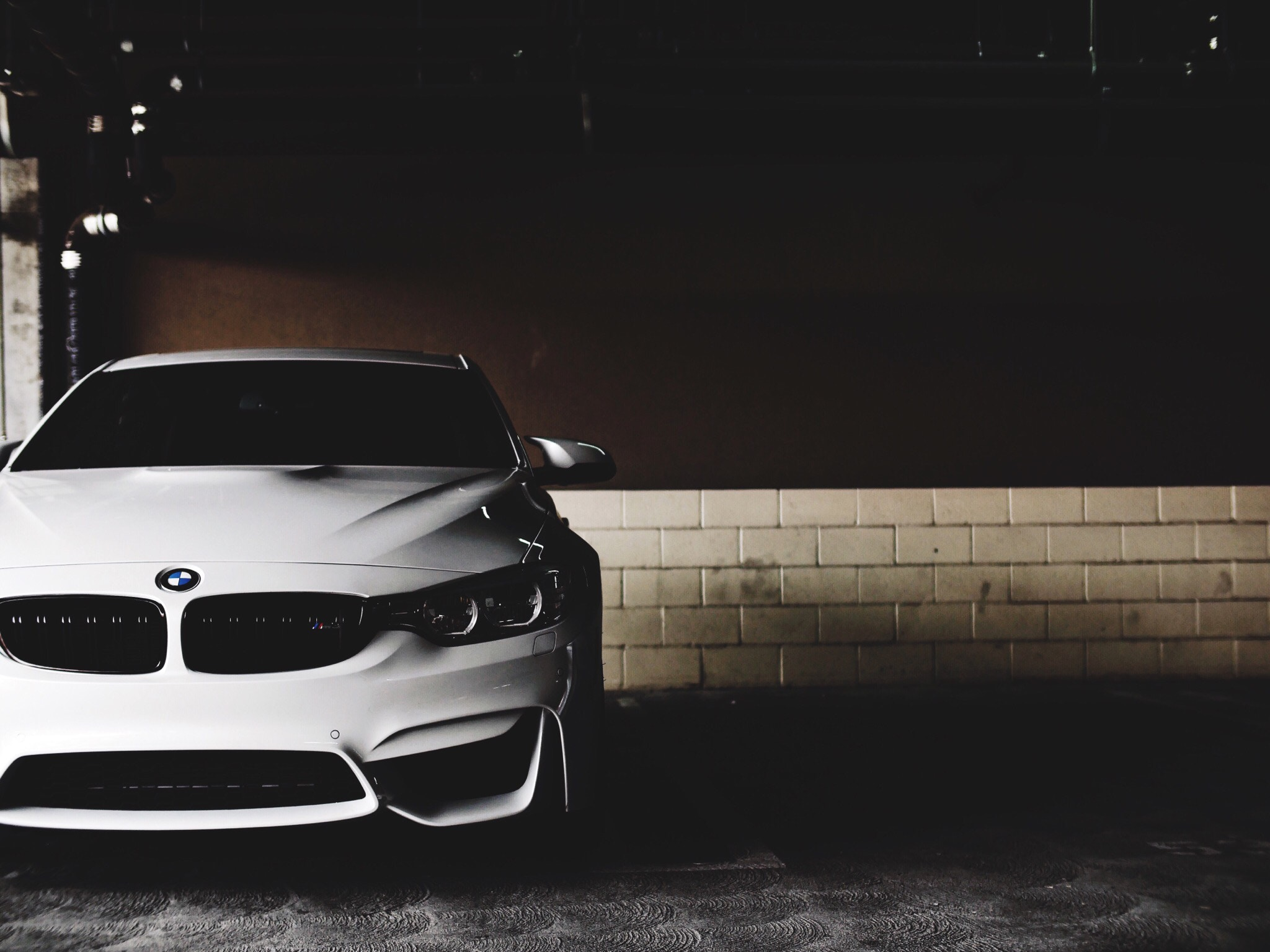 White BMW with shadowing