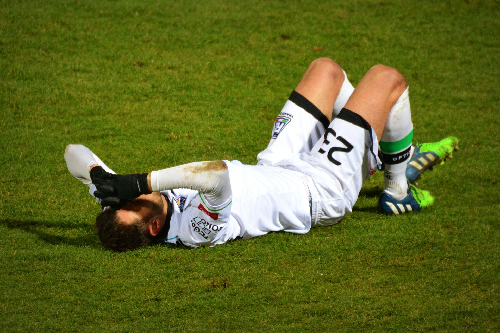 Prevent Sporting Injuries man playing football injured on the ground
